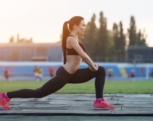 Girl squat exercising outdoors