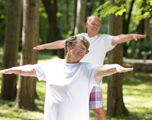 Older adults doing yoga outside