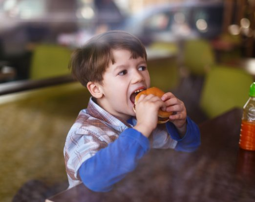 Young Boy Eating a Burger