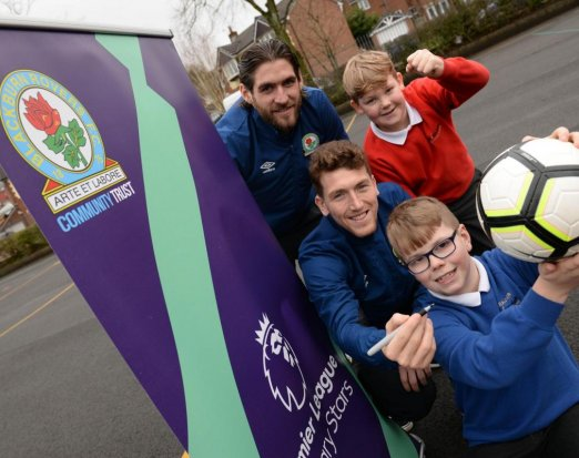 Two Blackburn Rovers Football Players Posing with Three Schoolkids