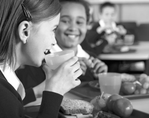 Two Young People Eating a Healthy School Lunch