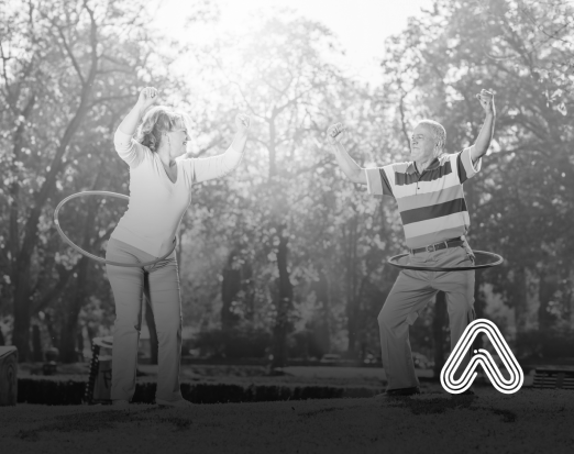 adults doing hula hoop