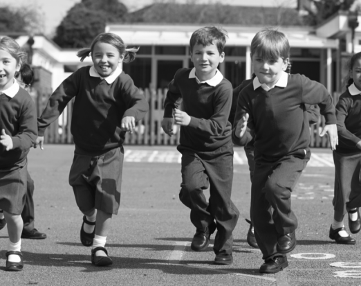 Primary School Children Running in the Playground