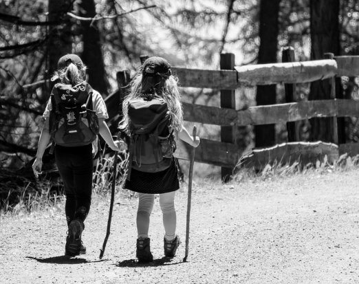 Two Young Girls with Backpacks Going on a Hike