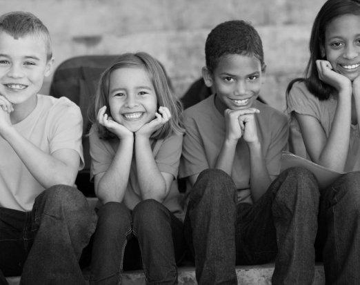 four-children-in-tshirts-smiling