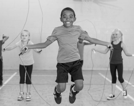 Children Playing Jump Rope in Gym Class