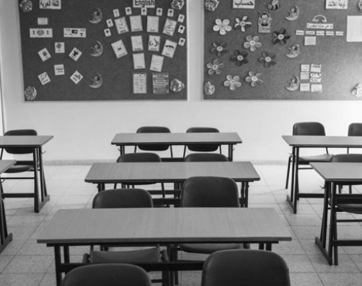 Empty Desks in Rows in a Classroom