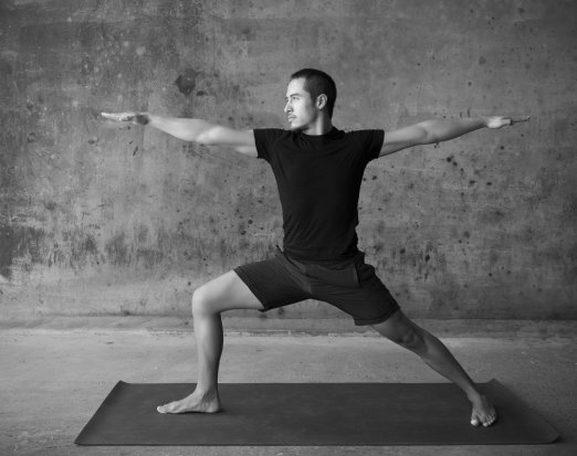 Man in Wide Legged Yoga Pose with Hands Outstretched