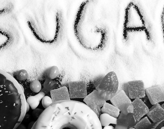 The Word Sugar Written In Granulated Sugar