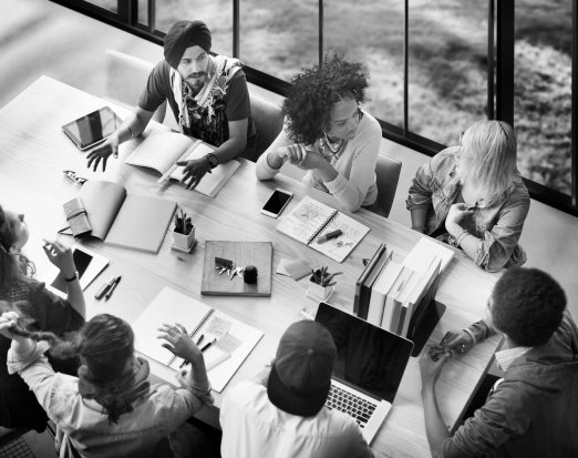 A Group of Teachers Brainstorming At a Desk