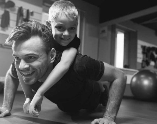 Dad and Young Son Doing Push Ups Together