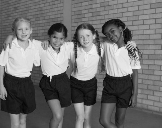 Four Young Girls Posing in School PE Kit