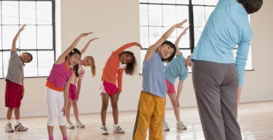 Children Doing Stretches With Their Teacher