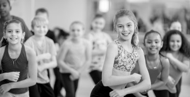 A Group of Children Smiling and Holding a Dance Pose