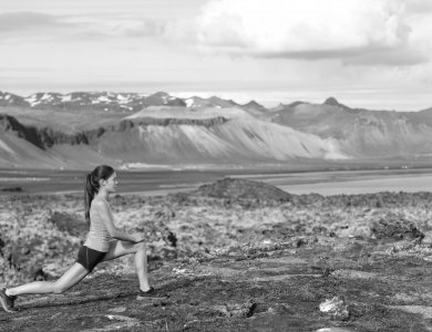 woman lunging on mountain